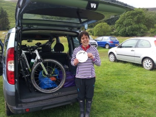 Car with both bikes and rain cover, me with welly boots and silver plate!