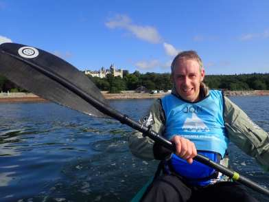 Leaving Dunrobin Castle - still smiling in the kayak for now!