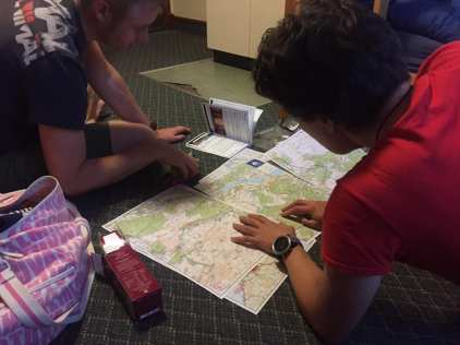Poring over the maps before the start